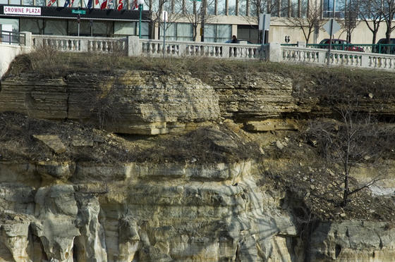 Walk another two blocks east to the Wabasha bridge. There you can see layers of different rock, laid down by a tropical ocean 470 to 440 million years ago. From top to bottom: the Decorah shale (fine clay from mid-level depths); Platteville limestone (dissolved shells from deep water); Glenwood shale; and St. Peter sandstone (sand from shallow water).
