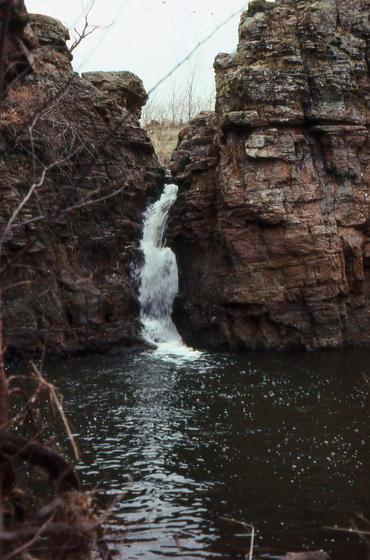 <strong>Pipestone Creek waterfall</strong><br />Pipestone Creek in southwest Minnesota carved this waterfall through Sioux quartzite. The rock appears red because it contains small amounts of iron.