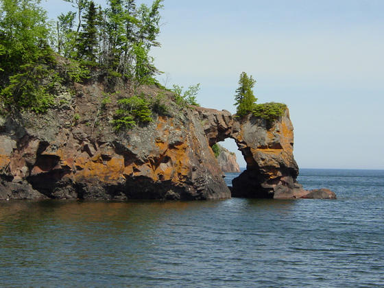 <strong>Cliffs at Tettegouce State Park</strong><br />Many Minnesota state parks hold interesting and beautiful geologic features. This cliff at Tettegouche was eroded by water. The reddish color in the rocks comes from small amounts of iron.