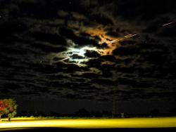 A Light in the Sky: Hayabusa streaked across the sky through the clouds as it re-entered Earth's atmosphere over the Woomera Test Range in Australia. In Kingoonya, the spacecraft's re-entry was visible to the human eye for 15 seconds.
