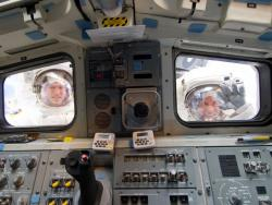 Another View: Astronauts Michael Good (left) and Garrett Reisman look through the aft flight deck windows of space shuttle Atlantis during the mission's third aspacewalk.