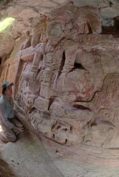 Maya frieze discovery: Archaeologist Francisco Estrada-Belli looks at the frieze discovered at the Holmul Archaeological Project.