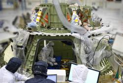 Orion power on: Technicians work inside the Orion crew module to prepare it for its first power on, a major milestone in Orion's final year of preparations before EFT-1.