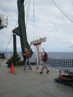 manta trawl: The trawl is hoisted above the stern deck of the RV Kilo Moana.