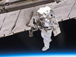 A Feat of Daring: Astronaut Garrett Reisman continued his work during the first of three planned spacewalks for the last Atlantis mission.