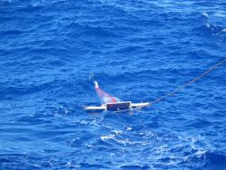manta trawl: The net is being pulled slowly through the ocean's surface water.