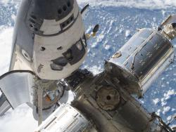 Docked at the Station: This image features the Atlantis' cabin and forward cargo bay and a section of the International Space Station while the two spacecraft remain docked, photographed during the STS-132 mission's first spacewalk.