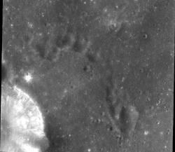 Chandrayaan-1 lunar image: Taken over the equatorial region of the Moon by Chandrayaan-1, the picture shows the uneven surface of the Moon with numerous craters. On the lower left, part of the crater Torricelli is seen.