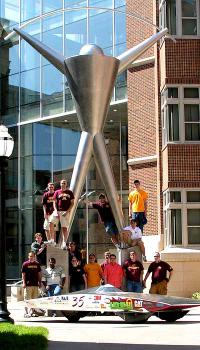 New Vehicle, Centaurus, to replace Borealis III: Borealis III, the 7th generation UMN solar car, with the Tin Man in front of the Mechanical Engineering building, U of MN. The Borealis 3 won 2nd place in the 2005 North American Solar Challenge (from Texas to Canada).