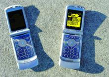 MEMS vs. conventional display: The phone on the right has a MEMS display, and the phone on the left doesn't. The photo was taken in sunlight; the brighter the ambient and natural light, the clearer the MEMS display. (Photo courtesy Qualcomm)