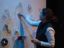 Krista Walsh adding to the installation