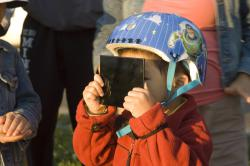 Viewing the eclipse: A helmet isn't necessary to view a solar eclipse, but proper eye protection against the sun's rays in essential.