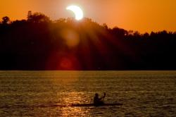 Kayak and eclipse