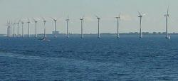 Is it possible to deflate hurricanes by wind energy?: Huge wind turbines off the coast of Denmark show a small-scale version of an off-shore wind farm that could sap the energy of hurricanes and tropical storms.