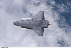 Endeavour's belly: A view of the Space Shuttle Endeavour as the crew puts the shuttle though a rendezvous pitch maneuver, allowing the crewmembers on the nearby International Space Station to document the vehicle's thermal protection system condition.  Image courtesy NASA.
