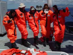 "teachers wearing ""gumby suits"": These total immersion, life-saving outfits protect people who need to abandon ships at sea."