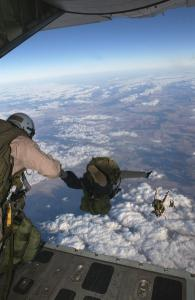 Parachutists of the Marine Corps's 1st Force Reconnaissance Company jump from the back of a C-130