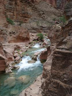 High and dry: Earlier this summer, hikers meandered along a trail high above Havasu Creek along the Grand Canyon. High rains this weekend flooded the side canyon, sending hikers and rafters high up the canyon walls to safety.