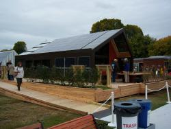 The ICON home's solar array: On the far left are solar thermal panels, in the middle are regular photovoltaic panels, and on the right are glass photovoltaic panels that can absorb light from both sides. The latter form a wall for the mudroom, and part of the awning above the deck.