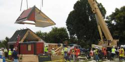 ICON Univ of MN Solar Decathlon enty: crane lowers a section of roof onto the University of Minnesota's Icon House, which arrived on the Mall Oct. 2. The house arrived several days late because of transport difficulties.