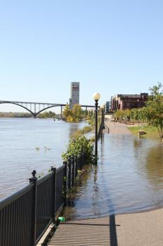 Walking path, east of Eagle St.: True, it's just that section, but the river hasn't even reached 16 feet yet.