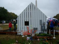 """University of Illinois at Urbana-Champaign: The second place house. Not a great picture. Imagine the rest as looking like this, but stretched into a rectangle. This was the only certified """"passive house."""" Its insulation and air exchange system make the house extremely efficient to heat and cool."""