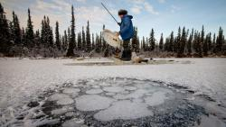 Scientists studying the release of methane at an Alaskan lake.