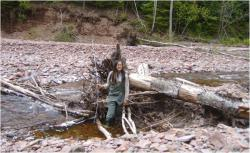 Vivian Leung with tree roots: Vivian Leung in the field researching woody debris