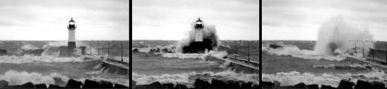 Gales of November: high waves overtake the lighthouse at the end of Canal Park's north pier in Duluth, Minnesota during a late autumn storm on Lake Superior.