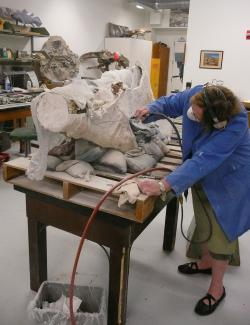 Removing Field Jacket: Back in the lab, the first step is to cut away portions of the plaster field jacket.
