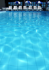 Caustics: What do the rippling patterns on the bottom of a swimming pool and cumulous clouds have in common? (Photo by R. Motti)