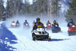 Yellowstone snowmobiles: A guide leads a pack of snowmobiles through Yellowstone National Park on a recent winter trip.
