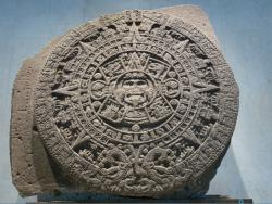 The Sun Stone calendar displays the 20 days of the Aztec month surrounded by symbols representing traditional Mesoamerican beliefs. But what does this Aztec calendar have to do with a Maya prophesy?
