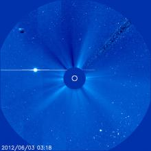 On approach: Venus (the bright white object) is seen heading toward its rendezvous tomorrow with the sun. The solar disk is obscured artificially by the SOHO spacecraft which captured the image yesterday (June 3, 2012).