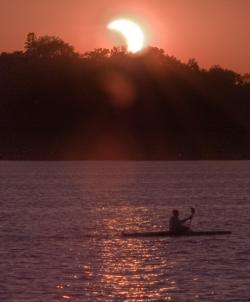 Partial eclipse over Lake Calhoun: Minneapolis, MN