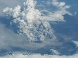Fluffy cloud of water vapor, or engine-clogging agent of doom?: Taken from Alaska Airlines jet on July 20, 2008. This photo of Alaska's Okmok volcano was taken from 37,000 feet up, looking south from about 15 miles to the north. Scientists estimate the top of the ash cloud was at 20,000 ft.