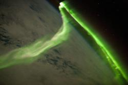 No, it's not the Green Lantern.: It's Aurora Australis, or the Southern Lights, as seen from the International Space Station.
