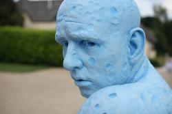 A blue sculpture of a man: or a sculpture of a blue man?