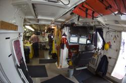 Blue Heron interior: Mid-deck area includes monitoring station, right, and one of two dry labs, background left, serving as a snack table during our trip.