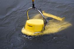 Yellow fish deployed: The EdgeTech CHIRP/sidescan sonar is submerged and towed behind the Blue Heron for gathering bottom data.