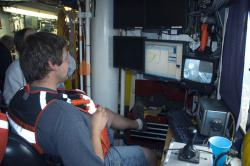 Topside control: Marine tech Jason monitors the submerged water sampling carousel, which can be controlled to collect water samples at different levels, as well as additional water quality data.