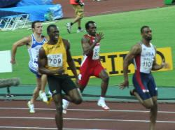 Bolting for gold: Jamaica's Usain Bolt (yellow jersey) became a two-time 100-meter gold medalist in the Olympics Sunday. How much has the winning 100 meter time decreased over the 116-year history of the Olympics?