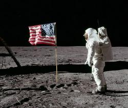 Man on the Moon: Astronaut Buzz Aldrin salutes one of the US flags planted during Apollo missions to the lunar surface.