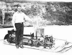 Carl J.E. Eliason of Saynor, Wisconsin Standing Next to His Snowmobile Prototype