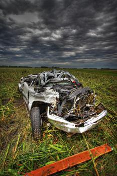 Chevy v. Tornado: It is a car smashed by a tornado.  But neither the car nor the tornado from the video link in this post.