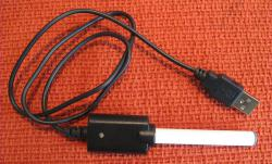 Electric cigarette: Connected to a USB charging cable, the e-cigarette's batteries can be recharged by getting hooked up to a computer. It releases a mist of nicotine to the inhaler to give them a smoking effect without the toxic chemicals.