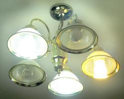 Compact fluorescent lighting: Changing lightbulbs. photo by Art Oglesby