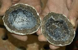 Split geode: blue quartz and geothite crystals line the interior cavity.