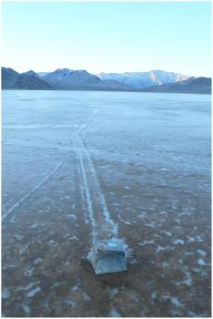 A walking test rock in Death Valley: A test rock fitted with a GPS unit shows evidence of movement across the ice covered Racetrack Playa in Death Valley.