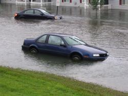 Wet wheels: These two cars in Goodview, Minn., were getting lost in the flood waters from the heavy rains of the past weekend. (Flickr photo by ssoross)